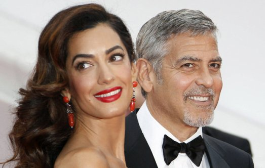 Amal and George Clooney are determine to keep their baby twins protected