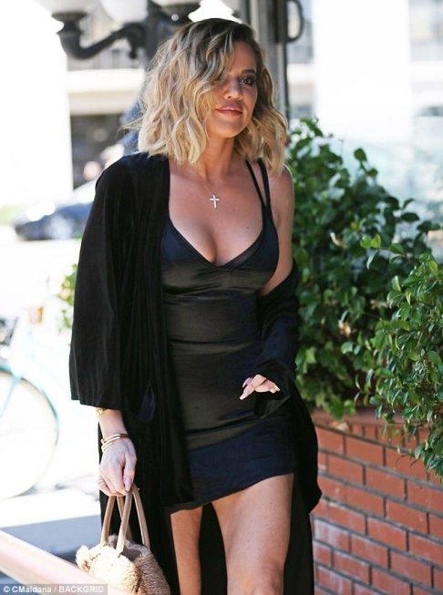 A bella sensation! Khloe Kardashian flaunts her bends in tight dark smaller than normal dress