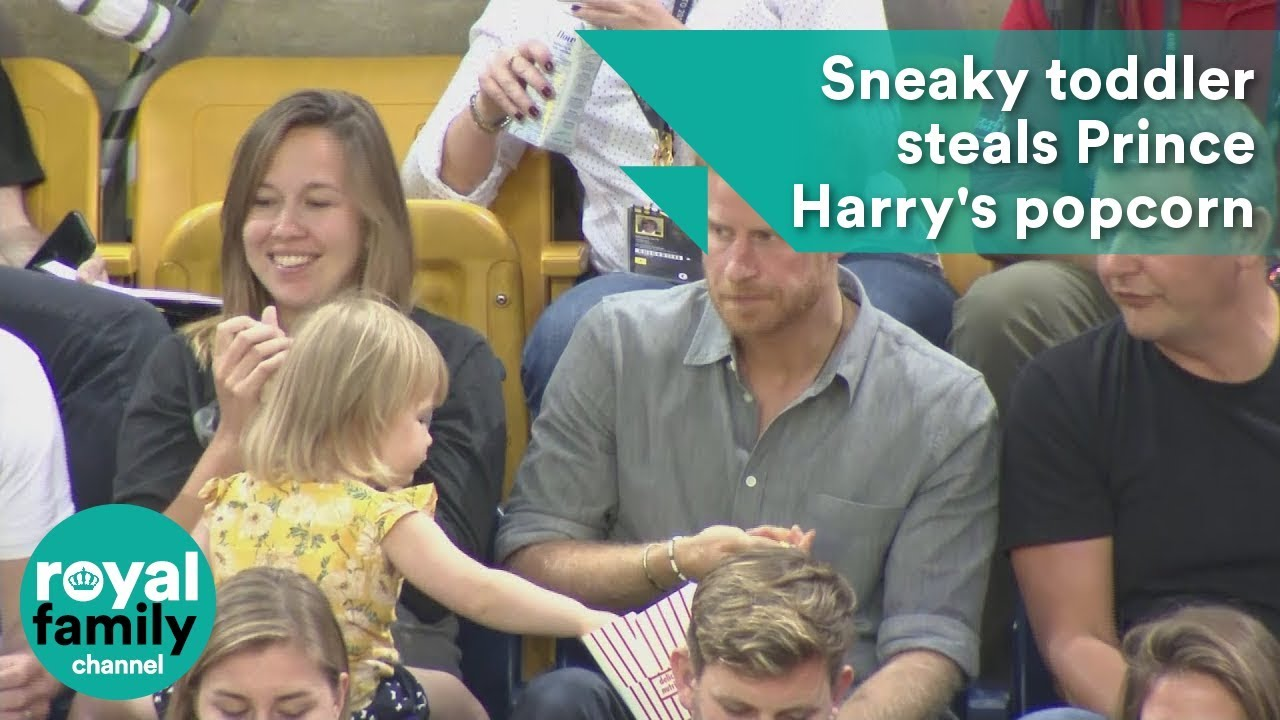 Sneaky toddler steals Prince Harry_s popcorn