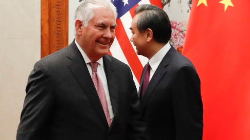 U.S. Secretary of State Rex Tillerson, right, walks by China's Foreign Minister Wang Yi before a meeting at the Great Hall of the People in Beijing, Saturday, Sept. 30, 2017. (AP Photo/Andy Wong, Pool)